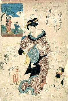 Japanese women in the process of putting her child on her back to wear.