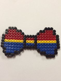 This says Wonder Woman but it looks closer to Captain Marvel to me :)  Wonder Woman Hair Bow perler beads by Leanna Borg