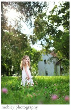 Field, old country home and little girl makes a great photo