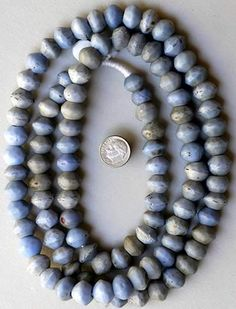 "Trade Beads | Long strand of opaque blue Bohemian ""Vaseline Beads""  All have truncated hole and are finished by hand  Date: Mid to late 1800s"