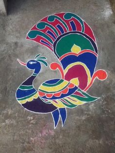 Peacock rangoli. It's not pinned by another person.. It's original by my sister on 1st day of diwali..