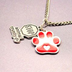 Red paw stop animal cruelty  necklace by MyTinyTemptations on Etsy, $12.99