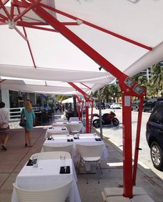 Customize your umbrellas to have a simple and light canopy color, and then choose a more flashy color for the structure to make them more eye-catching and striking. Light Canopy, Canopy Lights, Outdoor Umbrellas, Custom Design, Shades, Patio, Eye, Interior Design, Simple