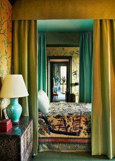Hutton Wilkinson designed this bedroom in Beverly Hills, the wallpaper is hand painted on silk, the draperies are celedon green silk lined in robins egg blue pongee.  The bedspread is an antique Chinese embroidery..   dovecotedecor.com