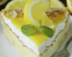Buy Piece Of Lemon Cake Tart by on PhotoDune. piece of lemon cake tart decorated with fresh lemon and mint Ww Desserts, Dessert Cake Recipes, Lemon Desserts, Dessert Weight Watchers, Sweet Cooking, Homemade Cheesecake, Baking And Pastry, Cake Cookies, Grands Parents