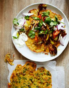 Chickpea pancakes with spiced roasted carrots and cauliflower – recipe by Bill Granger, via The Independent