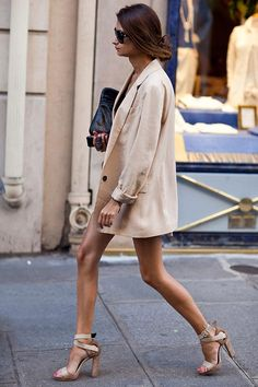 an oversized blazer paired with a dress or skirt that hits at the same length is contemporary and chic