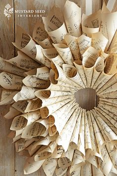 awesome wreath made out of book pages. would love to do this with an old hymnal! @Annie Genovese-Lohnes, this is what I was envisioning!
