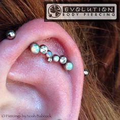 industrial piercing with titanium and opal jewelry by anatometal (at Evolution Body Piercing)