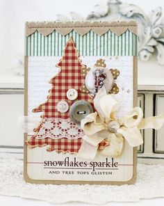 Blog: Lilybean's Paperie ~ This is a creative homemade Christmas Card. One of my favorite elements is the use of BuTtOns! ~ This Blogger is great because she usually posts links to the scrapbooking/craft supplies she used in making her creations...Like this one ~ ♥