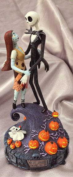 "Relive Jack and Sally's magical moment on Spiral Hill with the Simply Meant to Be Figurine. If you're a fan of Tim Burton's classic The Nightmare Before Christmas, you don't want to miss this musical tribute that plays ""Finale"" from the film and features eerie glowing pumpkins. Backed by the best guarantee in the business with returns up to one full year and free return shipping."