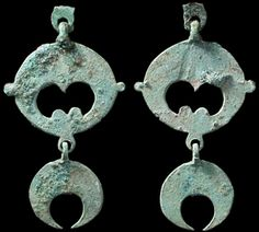 Lunulas Ancient Celtic, c. 1st century BC - 2nd century AD. Great bronze lunar pendant. Fully articulated with three conjoined elements. Likely a horse decoration. Nice olive-green patina with earthen deposits, top loop stabilized. 60 mm