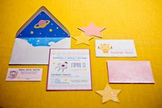 """Invitations: """"We turned blue astronaut suits and green spaceships pink and added a mix of cool chevron prints with pops of polka-dots,"""" Carlene says.  Source: Naturally Yours Events"""