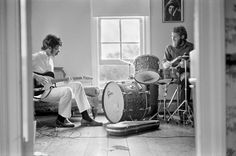 "Robbie and Levon, upstairs in Rick's home on Chestnut Hill Road, in the Zena area of Woodstock. Rick had married Grace and moved out of the house he shared with Levon and into his own home in a different area of Woodstock. It had extra rooms and a large basement that he turned into their rehearsal space. (This was not where ""The Basement Tapes"" were recorded.) Woodstock, NY, '69"