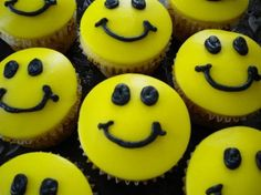 Black and yellow happy face cupcakes.