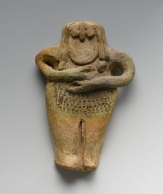 massarrah:  Female Figurine from Mesopotamia This terracotta female figure (14cm x 9cm x 2cm) shows a nude female with a large, patterned pubic area, conventions typical of female figurines from Mesopotamia that symbolize and emphasize fertility. The style of this patterning and of the facial features suggest it to be from the Early Dynastic III period. (Source) Terracotta, 3rd millennium BCE. Brooklyn Museum.