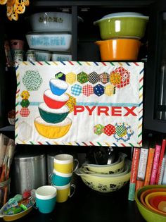 Pyrex Love Mini Quilt Wall Hanging. $58.99, via Etsy. This would look AMAZING in my kitchen!