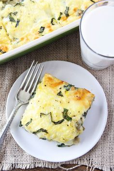 Spinach Artichoke Egg Casserole Recipe on twopeasandtheirpod.com This easy egg casserole is great for holidays! Our family loves it!