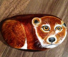 Little otter hand painted onto a smooth stone and glazed for a protective finish