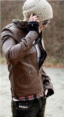 brown leather jacket and black jeans with plaid shirt