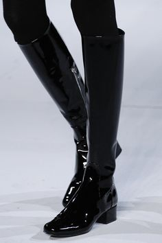 Black patent leather knee high boots. Saint Laurent, RTW FW 2014.