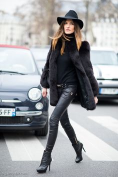 Shop this look on Lookastic: https://lookastic.com/women/looks/fur-coat-turtleneck-skinny-pants-ankle-boots-crossbody-bag-hat-belt/5425   — Black Wool Hat  — Black Turtleneck  — Black Leather Crossbody Bag  — Black Fur Coat  — Black Embellished Leather Belt  — Black Leather Skinny Pants  — Black Leather Ankle Boots