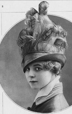 An extravagantly feathered toque by Jeanne Lanvin, 1914. The turned up collar was all the rage that year.