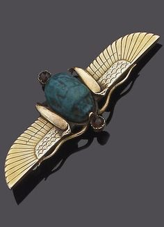 A 19th century winged scarab brooch, circa 1890. In archaeological revival style, the ancient scarab with circular-cut garnet highlights, between outstretched wings with engraved detail and applied serpent motifs.