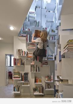 "library. @Carrie Wagler Swinging and reading! Actually this might give me a headache.. but I still like this idea as much as the sliding ladder. I think I'd read ""the Jungle Boy"" on this swing."