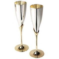 Bringing back an exceptionally popular Created classic. Celebrate in style with these silver-plated champagne flutes with brass stems. H24cm, capacity 125ml.