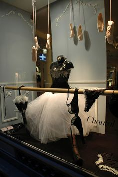 OK, so maybe you don't want to drape the underwear over a barre in your dance window display -- but the pointe shoes, umbrella and costume are neat ideas