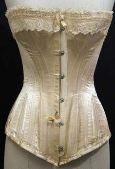 Antique Victorian Corset from 1890. Cream white satin fabric.