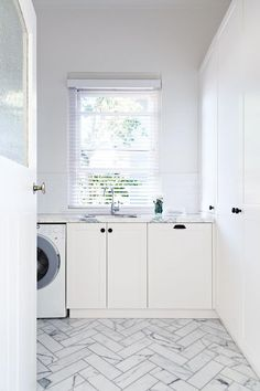 Luxe Laundry Room with Marble Inclusions