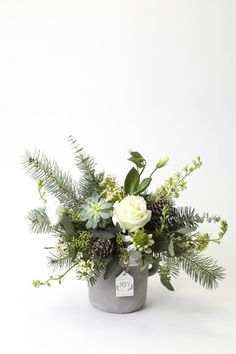 THE JOY OF CHRISTMAS. A wild 'just picked' design of succulents, roses, lakspur, cape lilies, wax flowers and Christmas greens. Winter Flower Arrangements, Christmas Arrangements, Floral Arrangements, Christmas Planters, Christmas Greenery, Christmas Decorations, Winter Centerpieces, Floral Centerpieces, Wedding Centerpieces