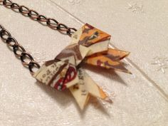 Origami Paper Bow Necklace by SLHJewellery on Etsy, £10.00