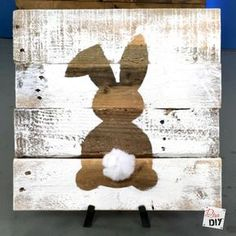 Rustic reclaimed wood signs are all the rage! Using pallet wood for the sign makes these signs a cheap and easy DIY to add to your Easter Decorations.