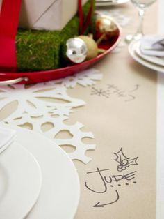 A roll of brown Kraft paper makes for a fun and disposable table runner. Write the name of each guest on the paper near their plate and encourage them to doodle during dinner, too. Photo by Layla Palmer.