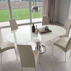 Giro Table already pinned twice -   different options.  Stainless Steel/White Glass shown in use