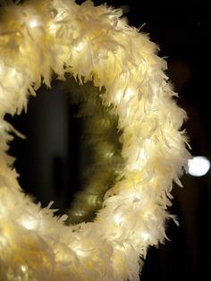 Add LEDs to a feather wreath OR feather boa - so magical: http://www.flashingblinkylights.com/blinkiesroundleds-c-114_61_1.html?osCsid=b1i0bqj8u8gq84u9it1t19euv5