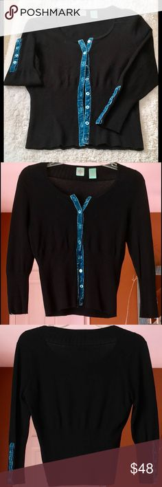 Anthropologie Cardi, Size Small A vintage Anthro piece.  Black cardigan with bright turquoise piping along front and on sleeves.  Excellent Used condition.  Polyester and Rayon combo.  You won't be disappointed. Anthropologie Sweaters Cardigans
