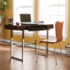 Create a sleek, modern work space with this contemporary chrome desk in a warm espresso finish. The clean lines and chrome legs give it a modern feel, while the center fold-down keyboard drawer provides practicality and storage options.