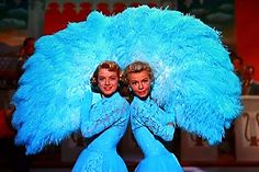 Rosemary Clooney and Vera Ellen in White Christmas. I'll have one of those's fans. #RosemaryClooney #VeraEllen