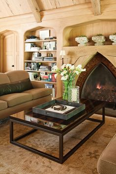 20 Cozy Cabin and Lodge Decorating Ideas....BEAUTIFUL fireplace...and blonde woods. A more modern take on a lodge look.