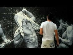 """Paolo Troilo: Exhuberant photo-realistic finger paintings  """"I paint my body with my body. I paint myself with myself,"""" he said. And, though his styles differ through time, he keeps coming back to the image of a man struggling against a white T-shirt.  """"The shirt keeps our head down, rules keep our creativity down. Every day, we fight to make our heads go like a balloon up, to enjoy that space that we don't usually see."""""""