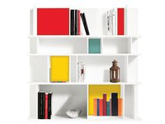 Spark up a white bookshelf by painting the backs of a few cubbies in fun colors