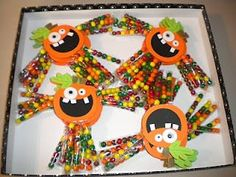 Pumpkin Candy Guys, use sixlets for the arms and legs. Perfect for school party!