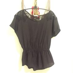 Black Chiffon peplum top This is such a cute top, has crochet detailing on the shoulder section, very slimming  comfy material it's almost like a less static chiffon material, the brand is from Nordstrom rack Lush Tops Tees - Short Sleeve