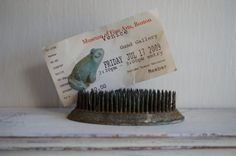 Use a flower frog as a photo holder! Flower Frog Vintage by kijsa on Etsy,