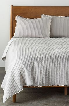 Free shipping and returns on Levtex 'Pom Pom' Quilt at Nordstrom.com. A streamlined, channel-stitched quilt has a pared-down profile that's fringed with fun pompoms.
