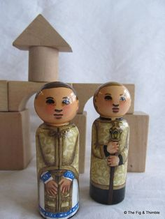 This is a beautiful and richly detailed set of two 3 1/2 inch tall hand painted wood peg dolls. The priest and his altar server are wearing traditional gold vestments, and the server is holding a torch. Note the beautiful vine and lily pattern of the brocade, and the icon on the Phelonion.  Note this listing is for the set of two peg dolls; blocks and other prop items not included.  These wood peg dolls are painted with acrylic paints and finished with acrylic sealer, all of which are AP...